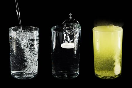 depressant: Glass with water and  tablet  on  black background