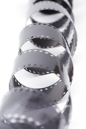 celluloid film: 35mm film spiral on white background Stock Photo