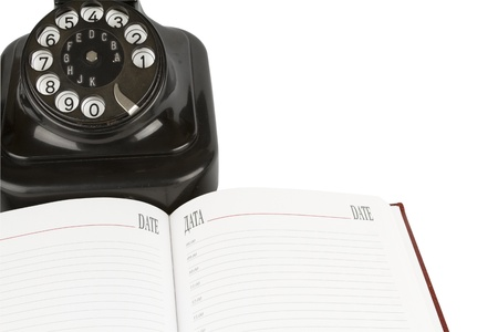 calender: Black retro-styled telephone, organizer of open blank page , isolated on white background