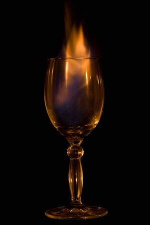 goblet: Fire in glass on  black background Stock Photo