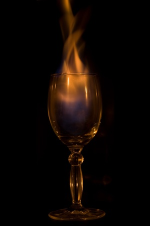 Fire in glass on  black background photo