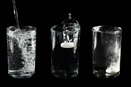 fizzy: Glass with water and  tablet  on  black background