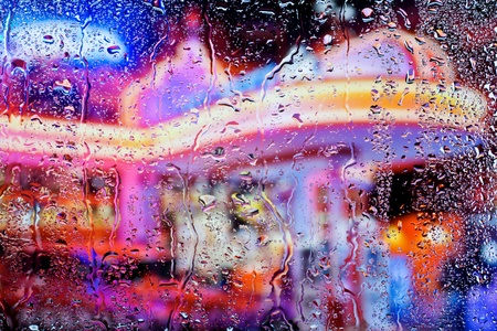 clean street:   Drops of water on the glass,Night city through wet window, Raindrops on the window at Night