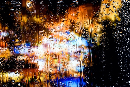 Blurred lights for wet window photo