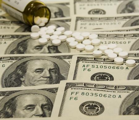 depressant: Background of Prescription drug bottle on  money,Bottle with tablets on dollars