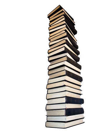 bibliomania: Tower  of old books. Isolated on  white background