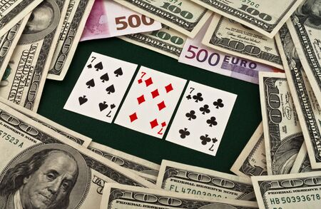 top seven: Playing cards and money