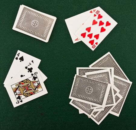 Playing cards on green table  photo