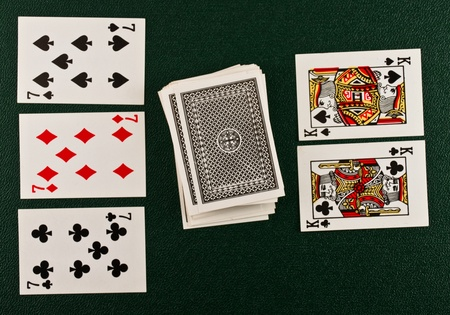 rummy: Playing cards on green table  Stock Photo