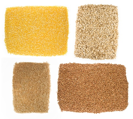 Oatmeal, buckwheat, millet, corn isolated on  white background photo
