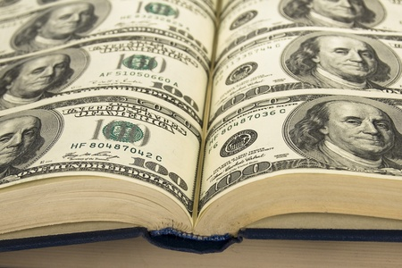 Dollars in book,Background of Money in book book with  pages of dollars photo