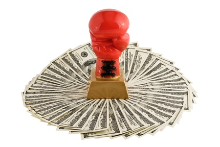 Boxer glove on dollars, isolated on white background Stock Photo - 11030316