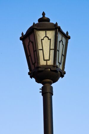 Street lantern  on  blue sky background. photo