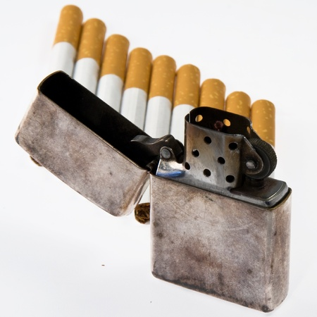 Cigarettes and lighters, isolated on white background photo
