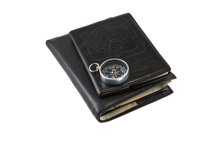Leather billfold, passport,compass.Isolated on white background.
