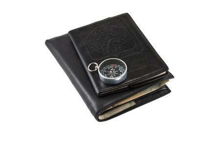 billfold: Leather billfold, passport,compass.Isolated on white background.