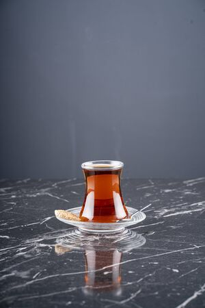 A cup of Turkish tea on marble table stock photo