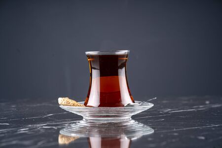 A cup of Turkish tea on wooden table stock photo Stock Photo