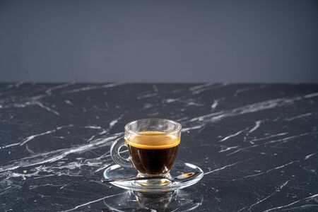 A cup of espresso on marble table stock photo