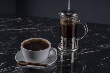 A cup of coffee on marble table stock photo Stock Photo