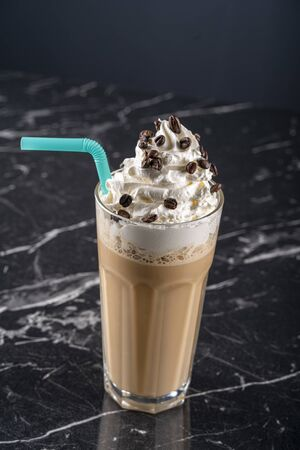 Latte macchiato with whipped cream, serving silver spoon and pitcher stock photo Stock Photo