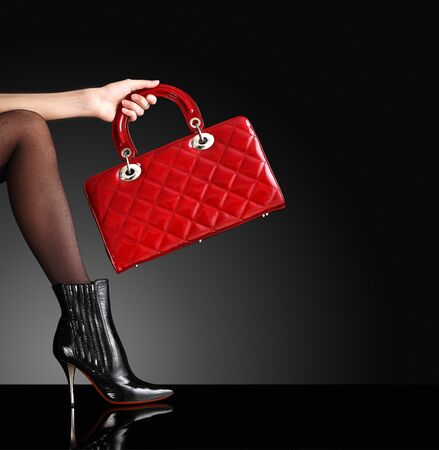 fashionable woman with a red handbag, only legs Stock Photo - 11793509