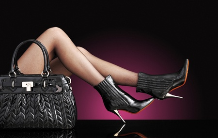 trendy: sexy woman with trendy black bag, only legs Stock Photo