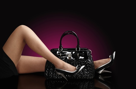 fashionable woman with a black bag, fashion photo photo