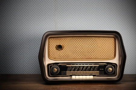 retro radio: antique radio on vintage background