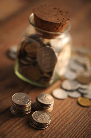 old coins on the wooden table, shallow dof photo