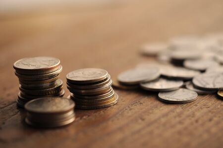 old times: old coins on the wooden table, shallow dof Stock Photo