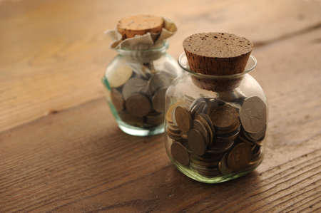 old coins on the wooden table photo
