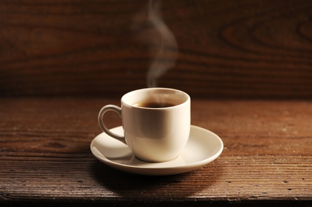 cafe table: cup of coffee on the wooden table Stock Photo
