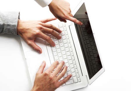 two business peoples at working on laptop, top view Stock Photo - 11853635