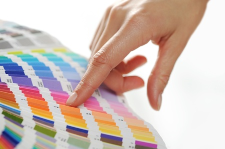 indicating: woman Choosing color from color scale