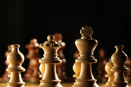 battling: View from behind the white pawns on a chess board Stock Photo