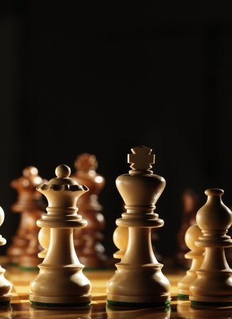 chess board: View from behind the white pawns on a chess board Stock Photo