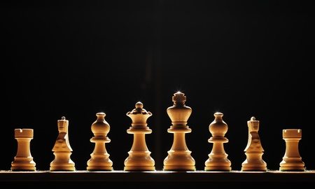 Chess pieces ready to do battle. Stock Photo