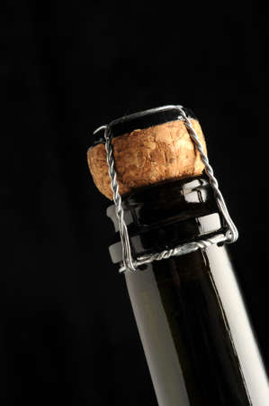 sparkling wine cap on black background
