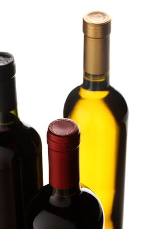 bottles of red and white wine on white background photo
