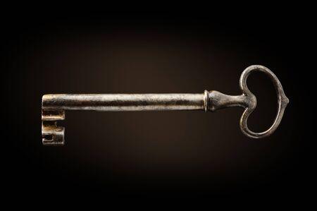 old key on dark background photo