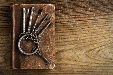 old keys on a old book, antique wood background photo