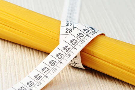 diet concept, Spaghetti with measuring tape  photo