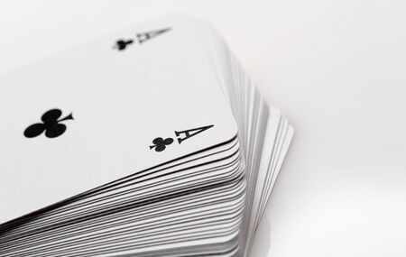 close up of playing cards poker game on white background photo