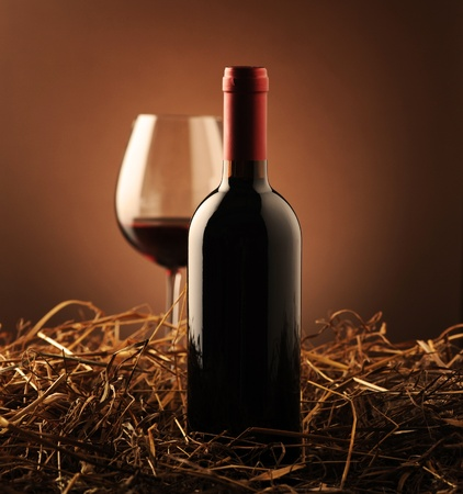red wine and wine glass on a dark background photo