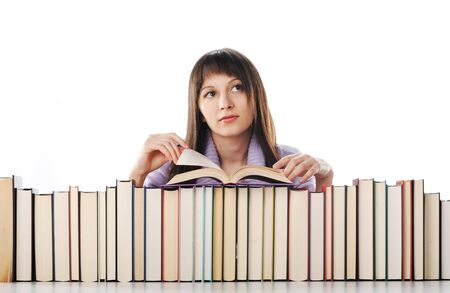 young woman behind a big pile of books  photo