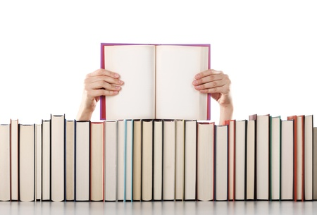 Woman hands holding an open book . Pages are blank photo