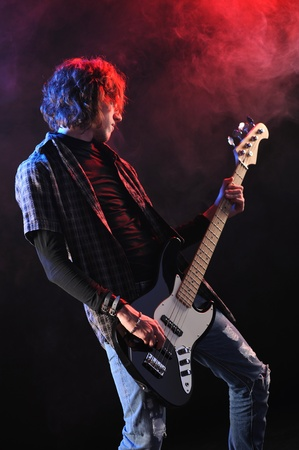 a bassist plays at a live concert Stock Photo