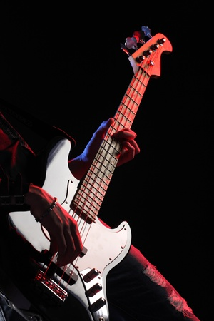 bass guitar: a bassist plays at a live concert Stock Photo