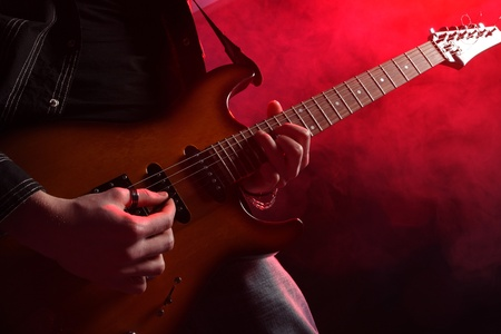 rock guitarist: rock guitarist playing at a live concert Stock Photo